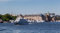 Stockholm sweeden a boat and the historical buildings of Stock Image