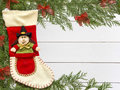 Stocking Befana and Christmas decorations on wooden white background Royalty Free Stock Photo