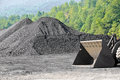 Stockpile of coal with endloader Stock Image