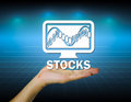 Stocks hand and sign with dark background Royalty Free Stock Photo