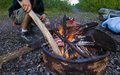 Stoking the Campfire Royalty Free Stock Photography