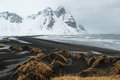 Stokksnes Peninsula, Vestrahorn mountains and black sand dunes over the ocean, Iceland Royalty Free Stock Photo