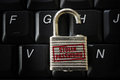 Stolen password lock broken on a computer keyboard with text Stock Photos