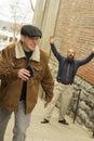 Stolen wallet hoodlum steals from balding bearded business man Royalty Free Stock Image
