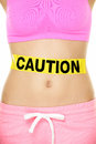 Stomach health concept showing woman belly caution sign take care of your body food poisoning or other conceptual healthy Royalty Free Stock Photos