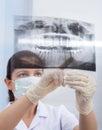Stomatologist Pointing At Jaw Xray