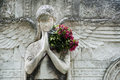 Stone angel with flowers statue père lachaise cemetery paris france Stock Image