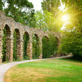 Stone arch in the park Royalty Free Stock Photo