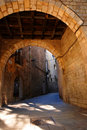 Stone arch to narrow alleyway Royalty Free Stock Photo