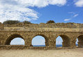 Stone arches of ancient Roman aqueduct Stock Photography