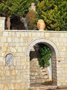 Stone archway and steps wall with decorative mosaic ceramic urns Royalty Free Stock Photography