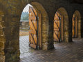 Stone archways with wooden doors open Stock Images
