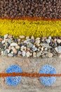 Stone background close up on an abstract composition made by multicolored sand and stones Royalty Free Stock Photo