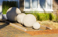 Stone balls garden sculpture curb appeal sphere details Stock Photography