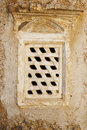 Stone barred window in stone wall a view of a with heavy bars an old Royalty Free Stock Images