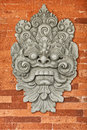 Stone bas-relief on the brick wall. Indonesia, Bali. Royalty Free Stock Image