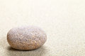 Stone beige in sand nature background with copy space macro shot Stock Photo