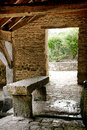Stone bench in antique wash house in rural village old an covered community laundry a small france Stock Photos