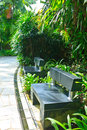 Stone bench black in the garden Royalty Free Stock Photos
