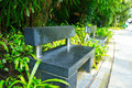 Stone bench black in the garden Royalty Free Stock Image