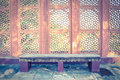 Stone bench with Indian style wall. Royalty Free Stock Photography