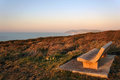 Stone bench near sea at sunset Stock Photography