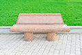 Stone bench in a public garden park. Stock Image
