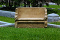 Stone bench terracotta colored in cemetery Royalty Free Stock Photo