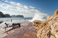 Stone breakwater with big waves petrovac montenegro adriatic sea Royalty Free Stock Photography