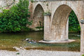 Stone bridge arches over tarn river in france Stock Image
