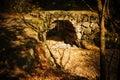Stone bridge with fallen leaves Royalty Free Stock Photo