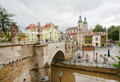Stone bridge over the river near the old town churches Royalty Free Stock Photo