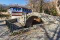Stone bridge over small river in Moushteni near Kavala, Greece Royalty Free Stock Photo