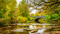 Stone Bridge in a park setting Royalty Free Stock Photo