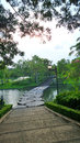 Stone bridge in the park syone over quiet lake evening Royalty Free Stock Photography