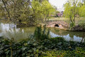Stone bridge in verdant lake a chinese ancient the of early spring chengdu china Stock Photos