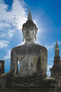 Stone Buddha with blue sky Royalty Free Stock Photo