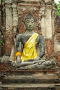 Stone Buddha with brick background Stock Photos