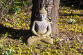 Stone buddha meditation in front of a cherry tree Stock Image