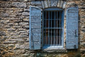 Stone building window of a bourbon distillery warehouse Stock Image