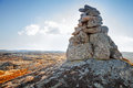 Stone cairn as a navigation mark on the top of norwegian mountain Stock Photography