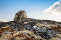 Stone cairn as a navigation mark on the top of norwegian rock Royalty Free Stock Image