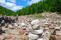 Stone cairn in mountain valleys in the spruce forest Royalty Free Stock Images