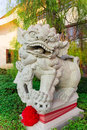 Stone carevd in lion shape  of the chinese temple Royalty Free Stock Photo