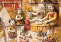 Stone carving of thai culture of songkran festival on temple wall Royalty Free Stock Photography
