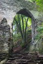 Stone castle gate in the woods Royalty Free Stock Photo