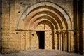 Stone church entrance door and arcs Royalty Free Stock Photo