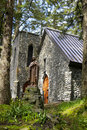 Stone church in the forest Stock Photos