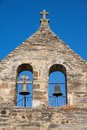 Stone church in rihonor de castilla belfry closeup Royalty Free Stock Photos