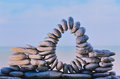 Stone circle arch of stones between of the pebbles on the coast Royalty Free Stock Images